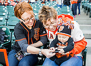 SAN FRANCISCO, CA - APRIL 18: San Francisco Giants fans admire their replica World Series rings prior to the San Francisco Giants World Series ring ceremony at AT&T Park on Saturday, April 18 2015 in San Francisco, California. Photo by Jean Fruth