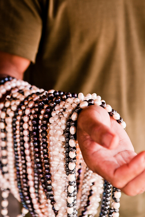 Selling pearl necklace at fishing village located on Komodo Island.