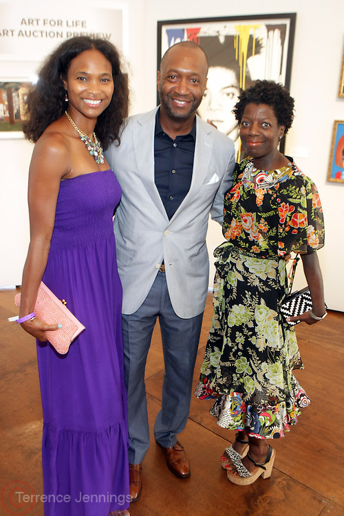 Water Mill, New York: (L-R) Nicole Friday, Jeff Friday, Founder & CEO, Film Life and Thelma Golden, Chief Curator, Studio Museum in Harlem attend the RUSH Philanthropic Arts Foundation 15th Annual Art For Life Benefit Gala held in the Hamptons at the Farmview Farms on July 26, 2014  in Water Mill, New York. (Terrence Jennings)