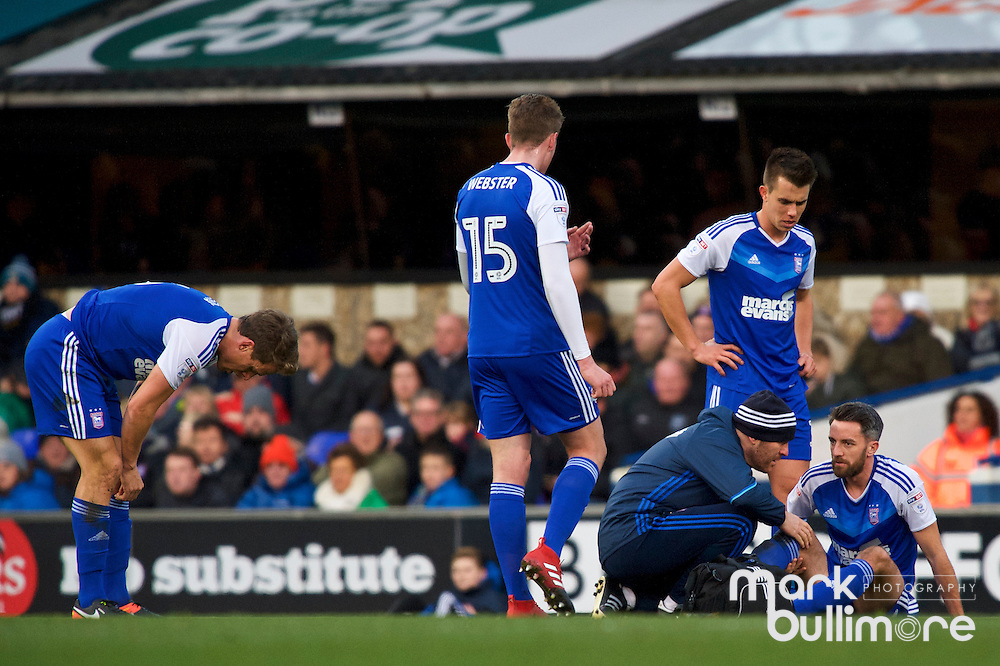 Ipswich, Suffolk. Football action from Ipswich Town v Fulham at Portman Road in the Sky Bet Championship on the 26th December 2016. Ipswich Cole Skuse  receives treatment on the pitch. <br /> <br /> Picture: MARK BULLIMORE