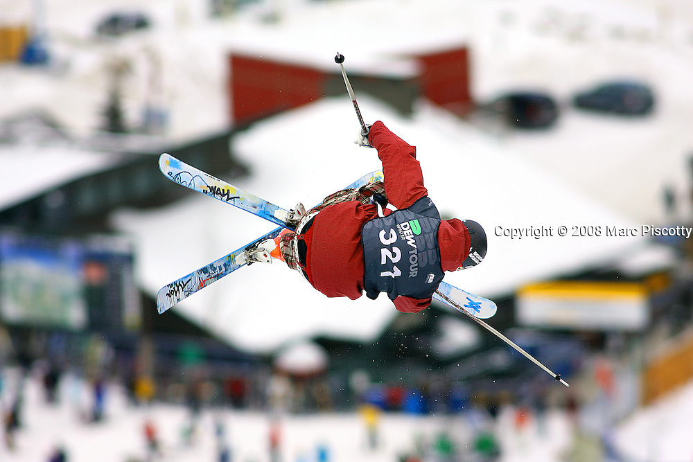 12/19/08 1:34:44 PM -- Breckenridge, CO, U.S.A. -- Skiier Lyndon Sheehan of Wanaka, New Zealand spins while airborne over the superpipe while competing at the inaugural Winter Dew Tour in Breckenridge, Co. on December 19, 2008. The four-day competition is the first of three stops on the tour that features freeskiing and snowboarding..(Photo by Marc Piscotty / © 2008)