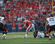 Mississippi quarterback Barry Brunetti (11) is sacked by \Southeast Missouri State's Wisler Ymonice (5) at Vaught-Hemingway Stadium in Oxford, Miss. on Saturday, September 7, 2013. (AP Photo/Oxford Eagle, Bruce Newman)