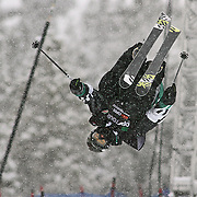 SHOT 12/18/10 10:36:55 AM - Thomas Krief of Alpe D'huez gets inverted while competing in the Ski Superpipe Finals during the Nike 6.0 Open stop of the Winter Dew Tour at Breckenridge Ski Resort in Breckenridge, Co. Krief finished fourth with a score of 85.00. The event features ski and snowboard slopestyle and superpipe. (Photo by Marc Piscotty / © 2010)