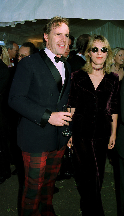 MR & MRS JAMES LINDSAY, she was a former friend of the Marquess of Blandford, at a reception in London on 7th June 1997.LZA 48