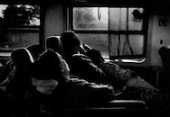 "Daybreak on the ""Down"" train from Mandalay to Rangoon (Yangon), Burma (Myanmar)."