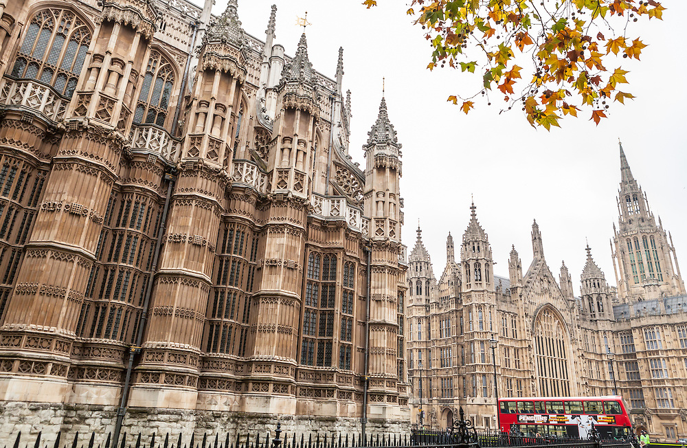 A view of both a portion of Westminster Abbey and Westminster Palace where the House of Lords and House of Commons exist, London, England, United Kingdom.