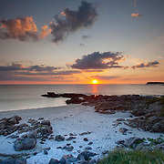 Sunset over the west facing beaches, isle of Barra, Outer Hebrides.