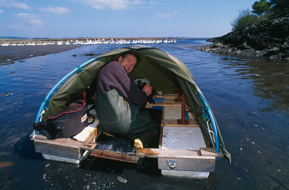 Niall Benvie using his floating hide, Montrose Basin, Scotland