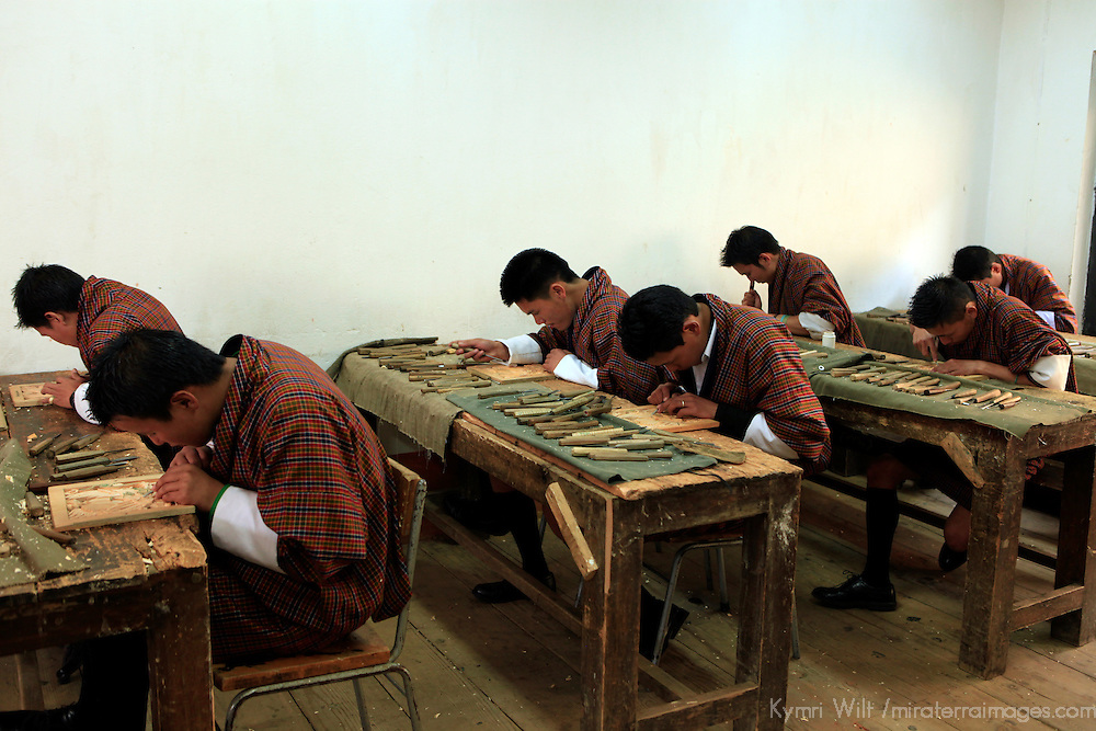 Asia, Bhutan, Thimpu. Students of the traditional Bhutanese art of woodcarving.