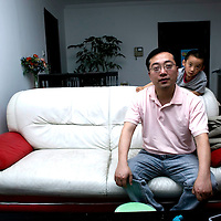 BEIJING, MAY 28, 2009 : Wang Guangze, former editor of 21st Century Business Herald, poses in his apartment in Beijing.