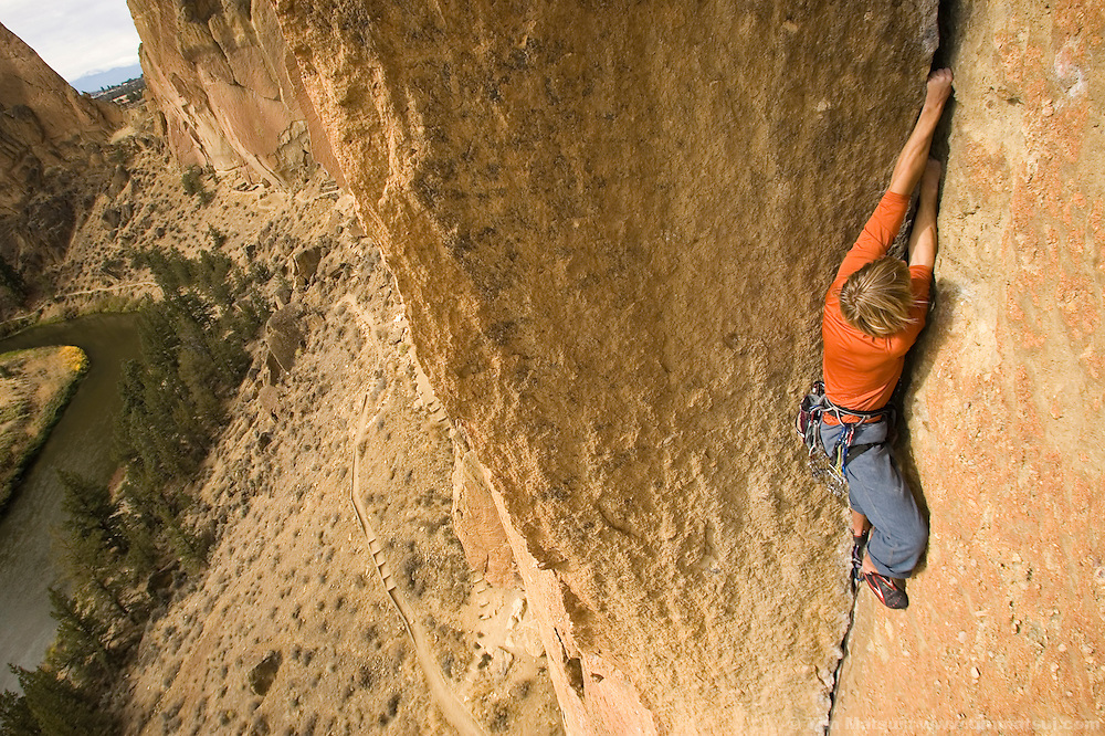 SMITH ROCK, OR - Climber, surfer, photographer, and cancer survivor Ben Moon climbs the route Zebra-Zion, 5.10c, at Smith Rock State Park, Oregon. He is belayed by Kim Lambert.