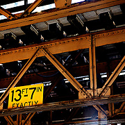 "SHOT 4/23/12 5:11:09 PM - A maximum clearance warning sign under a set of tracks for the L system in Chicago, Ill. The 'L' (also incorrectly written, ""L"", El, EL, or L, short for ""elevated"") is the rapid transit system serving the city of Chicago and some of its surrounding suburbs. It is operated by the Chicago Transit Authority (CTA). It is the second longest rapid transit system in total track mileage in the United States. Chicago is the largest city in the US state of Illinois and the third most populous city in the United States, with around 2.7 million residents. Its metropolitan area, sometimes called ""Chicagoland,"" is the third largest in the United States, with an estimated 9.8 million people within its metropolitan area. Chicago is the county seat of Cook County. Chicago has many nicknames, which reflect the impressions and opinions about historical and contemporary Chicago. The best known include: ""Chi-town,"" ""Windy City,"" ""Second City,"" and the ""City of Big Shoulders. (Photo by Marc Piscotty / © 2012)"