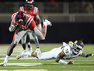 Mississippi wide receiver Vince Sanders (10) is tackled by Mississippi State defensive back Jay Hughes (30) at Vaught Hemingway Stadium in Oxford, Miss. on Saturday, November 24, 2012. (AP Photo/Oxford Eagle, Bruce Newman).