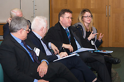 Portcullis House, Westminster, London, January 14th 2014. Members of the Residential Landlords Association attend the launch of their Policy Manifesto and hear views from MPs. PICTURED: A woman in the audience discusses a point with the panel.