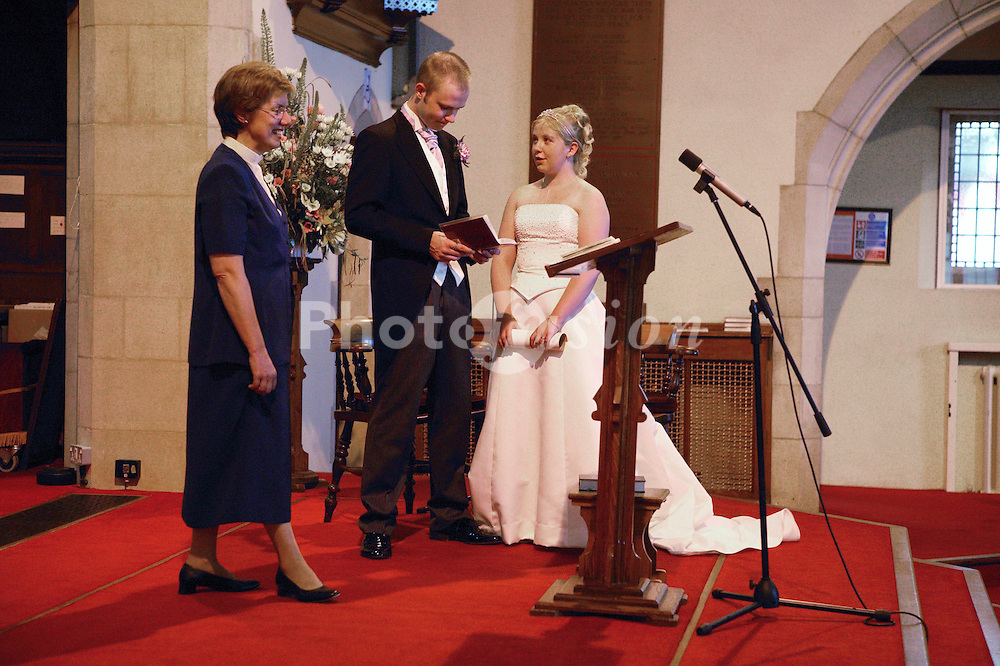 Bride and groom saying wedding vows during marriage ceremony,