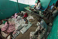 RENDEL, HAITI - OCTOBER 12, 2016:  The small clinic in Rendel, Haiti is overflowing with Cholera patients, and more keep coming. The United Nations Secretary General, Ban-ki Moon, chastised the international community on a recent visit for its paltry giving to Haiti this time around. Of the $120 million needed for the hurricane response, less than 20 percent has materialized. The waste of the past, and a general fatigue with Haiti, has hampered fundraising, donors say. Meanwhile, as cholera surges in areas where water and sanitation were already minimal, the nation is reminded that it was United Nations peacekeepers stationed in Haiti after the earthquake who first brought the disease to the country.