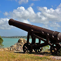 Cannon at Fort James in St. John&rsquo;s, Antigua<br /> This is one of 10 cannons around Fort James at the northern entrance of St. John&rsquo;s Harbour in Antigua.  Each of these 2 &frac12; ton cannons could fire a 24 pound ball up to 1 &frac12; miles.  What is surprising is that these museum quality guns are rarely visited.  Instead, they are rusting away among the ruins of the British fort yet are still pointing out to sea as if waiting since 1706 for a battle that never happened.