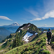 Hike Goat Ridge in Goat Rocks Wilderness Area, Gifford Pinchot National Forest, Washington, USA. A lenticular (lens shaped) cloud rides an atmospheric wave in the lee of Mount Adams, (12,281 feet / 3743 meters elevation), the second-highest mountain in the state of Washington, a potentially active stratovolcano in the Cascade Range. Published in Backpacker Magazine July/August 2013 in half page size (Cruz Bay Publishing, Inc).