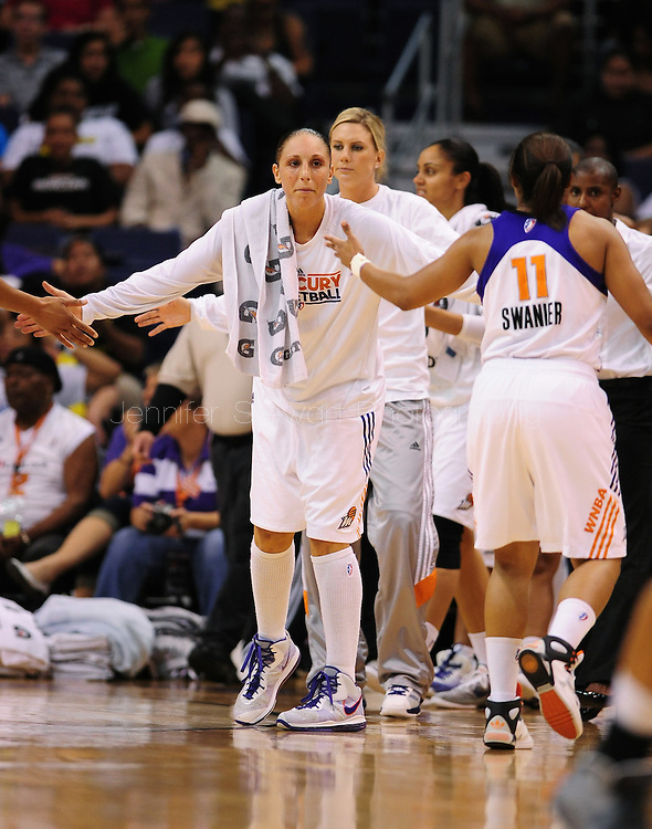 Sep 11, 2011; Phoenix, AZ, USA; Phoenix Mercury guard Diana Taurasi (center) reacts from the bench while playing against the Minnesota Lynx at the US Airways Center.  The Lynx defeated the Mercury 96-90. Mandatory Credit: Jennifer Stewart-US PRESSWIRE..