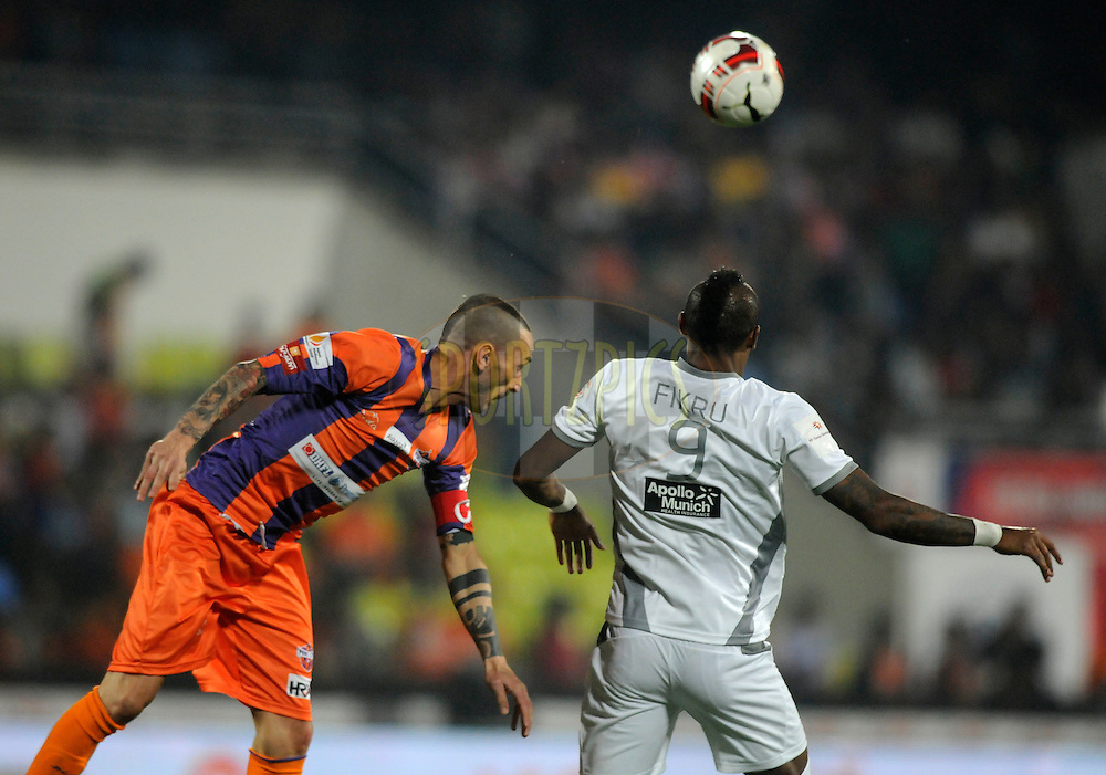 Bruno Cirillo of FC Pune City and Fikru Tefera Lemessa of Atletico de Kolkata during match 44 of the Hero Indian Super League between FC Pune City and Atletico de Kolkata FC held at the Shree Shiv Chhatrapati Sports Complex Stadium, Pune, India on the 29th November 2014.<br /> <br /> Photo by:  Pal Pillai/ ISL/ SPORTZPICS