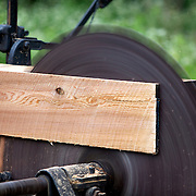 A log cutting demonstration part of the circle saw exhibit  of a 30 building re-creation based on Wisconsin villages a century ago. ..Horse Drawn Days was held Saturday, June 12, 2010 at Stonefield Historic Site near Cassville, Wisconsin.