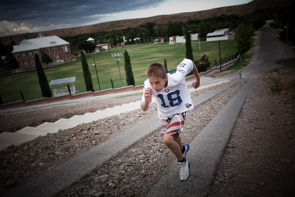 Gunner Romney, 11, trains by running up a large hill in Colonia Juarez, Mexico in July 2011. United States Presidential candidate Mitt Romney's family migrated to Mexico over 100 years ago after being granted asylum from Mexican President Porfirio Diaz after they had been pursued by the U.S. authorities for polygamy. ..(Romney is currently running for the Republican nomination.)