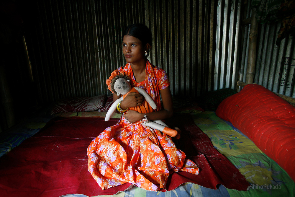 Sex worker Ratna, 13, is seen at brothel, July 7, 2007 in Dorothea, Bangladesh. She has been working as a sex worker for 4 years.<br /> <br /> The majority of the 20,000 to 30,000 female sex workers in Bangladesh are victims of trafficking. <br /> Once they enter the brothel, usually before the age of 12, they are generally in for life because of social stigma and poverty.