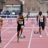 From left to right: Anthony Kiser (Bowie State), Demtrius Barkley (Bowie State), Umar Hasan (St. Rose), and Oluwatobi Owolabi (Bowie State) compete during the College Men's 400m Hurdles Championship during the Penn Relays athletic meets on Friday, April 27, 2012 in Philadelphia, PA.