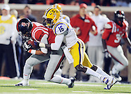 Mississippi wide receiver Donte Moncrief (12) is tackled by LSU's Tre'Davious White (16) at Vaught-Hemingway Stadium in Oxford, Miss. on Saturday, October 19, 2013. Mississippi won 27-24. (AP Photo/Oxford Eagle, Bruce Newman)