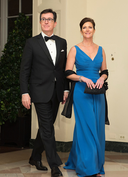 Comedian Stephen Colbert and his wife Evie Colbert arrive for the State Dinner being held for French President Francois Hollande at the White House in Washington on February 11, 2014.      REUTERS/Joshua Roberts    (UNITED STATES)