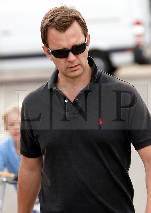 © licensed to London News Pictures. LONDON, UK  11/07/2011. Former News of the World editor Andy Coulson pictured today (Monday) walking his dog with his family in Dulwich Park. Please see special instructions for usage rates. Photo credit should read CLIFF HIDE/LNP (CHILD'S IDENTITY PIXELATED BY LNP)