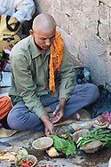 Brahmin priests at Pashipatinath, Nepal. This is Nepal's most important Hindu temple and honors Shiva in the form of Pashipati, lord of the beasts. It is considered aupicious to be cremated here.