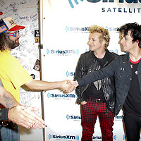 Green Day visits the studios of SiriusXM and meets Judah Friedlander on September 14, 2012 .L to R ; Mike Dirnt, Judah Friedlander ,Tre Cool, and Billie Joe Armstrong.