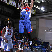 Delaware 87ers Forward Drew Gordon (32) drives towards the basket as Grand Rapids Drive Center Hasheem Thabeet (34) looks on the in the first half of a NBA D-league regular season basketball game between the Delaware 87ers and the Grand Rapids Drive (Detroit Pistons) Saturday, Apr. 04, 2015 at The Bob Carpenter Sports Convocation Center in Newark, DEL.