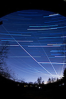 Winter Sky Star and Jet Trails. Image taken with a Nikon D700 and 16 mm f/2.8 fisheye lens (ISO 200, f/2.8, 300 sec). Composite of 35 images processed with Startrails program.