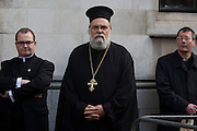 Intert-denominational clergy  await the order to enter Westminster Abbey where Pope Benedict XVI is to address VIPs during papal tour of Britain 2010, the first visit by a pontiff since 1982. Taxpayers footed the £10m bill for non-religious elements, which largely angered a nation still reeling from the financial crisis. Pope Benedict XVI is the head of the biggest Christian denomination in the world, some one billion Roman Catholics, or one in six people. In Britain there are about five million Catholics but only a quarter of Catholics regularly attend Sunday Mass and some churches have closed owing to spending cuts.