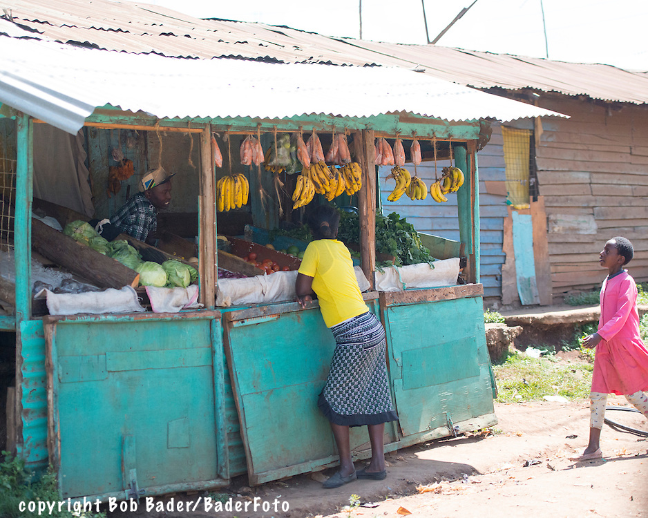 Woman at a fruit and vegetable stand in Nairobi Kenya's Kibera Slum
