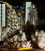 The Clarion Hotel and Casino is imploded in the early morning hours in Las Vegas Tuesday, Feb. 10, 2015. The hotel, opened in 1970, was once owned by actress Debbie Reynolds and named the Debbie Reynolds Hollywood Hotel. A mixed-use resort, catering to convention-goers, is planned for the site, according to developer Lorenzo Doumani. L.E. Baskow