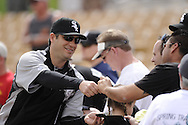 GLENDALE, AZ - MARCH 05:  Manager Robin Ventura #23 of the Chicago White Sox signs autographs prior to the game against the Los Angeles Dodgers on March 5, 2012 at The Ballpark at Camelback Ranch in Glendale, Arizona. The Dodgers defeated the White Sox 6-4.  (Photo by Ron Vesely)  Subject:  Robin Ventura