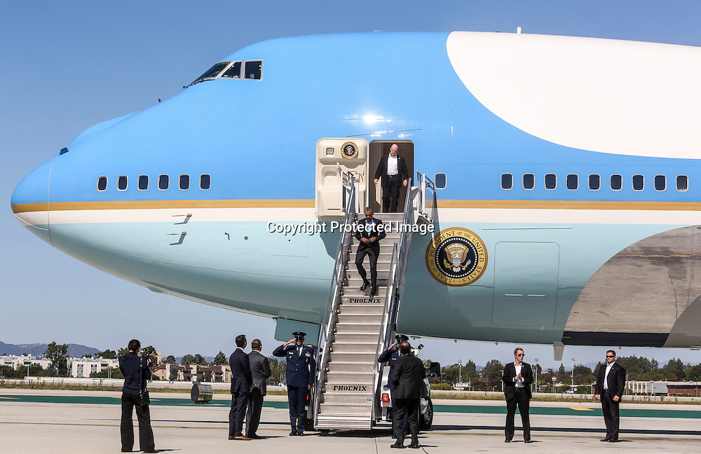 President Barack Obama walks off of Air Force One at Los Angeles International Airport in Los Angeles Sunday, Oct. 10, 2015.  (AP Photo/Ringo H.W. Chiu)