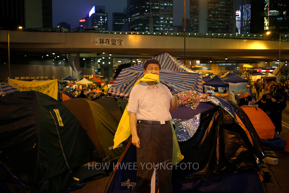 epaselect epa04512940 A life size cut out of Chinese President Xi Jinping among tents and shelters of pro-democracy students at the mass civil disobedience campaign Occupy Hong Kong camp in the Admiralty district of Hong Kong, China, 03 December 2014. Demonstrators have occupied three key areas of the city for more than two months, including business and commercial districts, to protest Beijing's decision to limit the electoral process for the territory's next chief executive in 2017.  EPA/HOW HWEE YOUNG