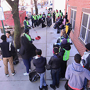 Volunteers assemble in front of The Delaware Valley Development building on North Jefferson Street prior Inaugural Trash to Cash event Monday, Jan 19, 2015 in Wilmington, Del.