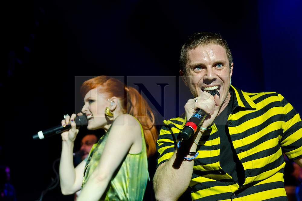 """© Licensed to London News Pictures. 16/05/2012. London, UK. Scissor Sisters perform live at O2 Shepherd's Bush Empire.  They are to perform as part of London's Olympic Festival on the BT River of Music America's Stage during the weekend of the 21-22 July 2012.  The group's fourth album """"Magic Hour"""" is due to be released on 28th May.  Scissor Sisters are an American band, formed in 2001, the band """"spawned by the scuzzy, gay nightlife scene of New York"""".  Its members comprise Jake Shears and Ana Matronic as vocalists, Babydaddy as multi-instrumentalist, Del Marquis as lead guitar/bassist, and Randy Real as drummer.  In this picture - Ana Matronic, Jake Shears.  Photo credit : Richard Isaac/LNP"""