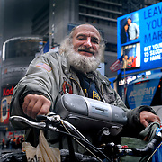 Radioman, photographed in New York City a former homeless man on the New York streets whose real name has been cited at Craig Castaldo or Craig Schwartz. He has appeared in over 100 movies in cameo roles. He is named for the radio he carries around his neck. The documentary 'Radioman' was released in April 2012