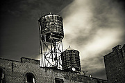 Water tanks on a building roof in SoHo, Manhattan, New York, 2009.