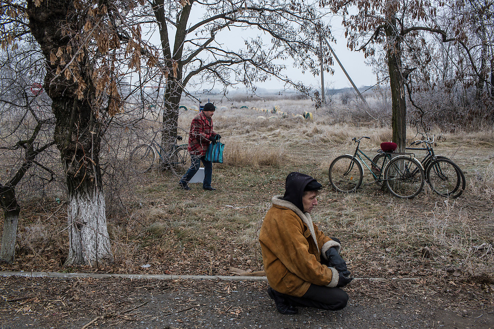 Local residents wait for a delivery of aid by the ICRC on Friday, December 11, 2015 in Troitske, Ukraine.
