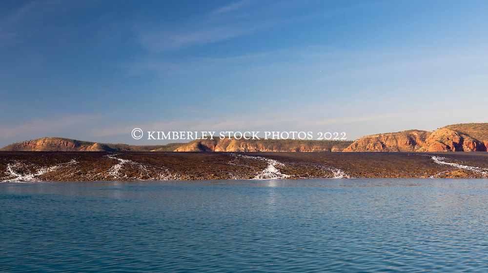 Water rushes off Turtle Reef with an outgoing tide in Talbot Bay on the Kimberley coast.