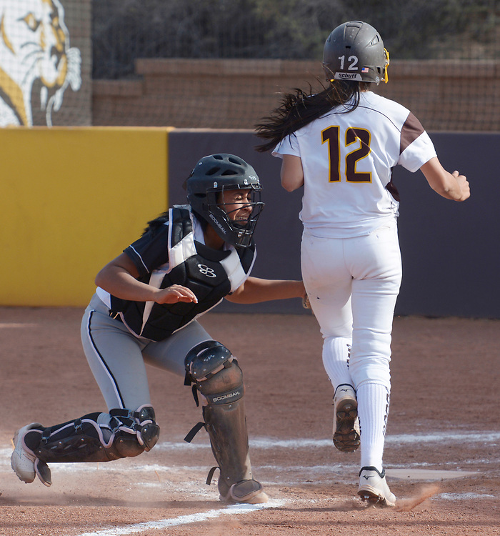 gbs040617n/SPORTS -- Volcano Vista catcher Akia Marshall tags out Cibola's Lidia Castellano, 12, during the game at Cibola on Thursday, April 6, 2017. (Greg Sorber/Albuquerque Journal)