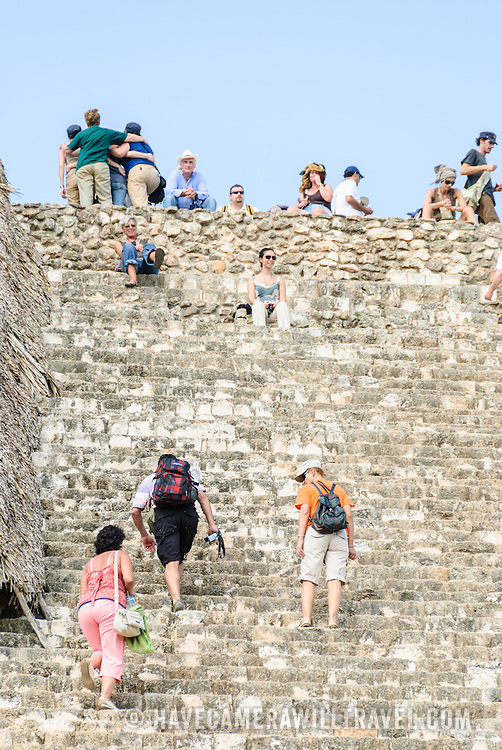 Tourists climb the many steps of the Acropolis at Ek'Balam, one of the Mayan civilization ruins on Mexico's Yucatan Peninsula not far from Coban and Chichen Itza.