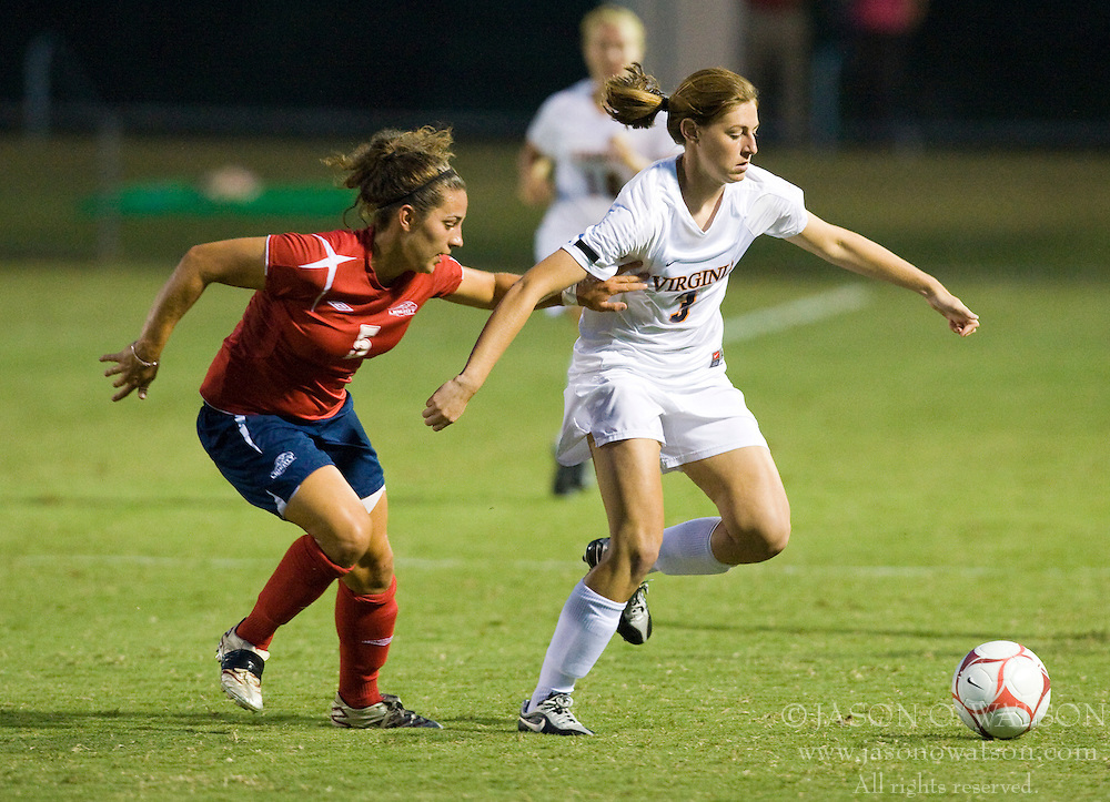 Virginia Cavaliers defender/forward Molly McKeon (3) battles with Liberty Flames defender Rachel Wisehart (5).  The Virginia Cavaliers defeated the Liberty Flames 5-0 in women's soccer at Klockner Stadium on the Grounds of the University of Virginia in Charlottesville, VA on August 29, 2008.